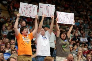 From left, Sam Brueggeman, 16, and his parents Bill and Carol, of North Freedom, Wis., lead a cheer while waiting for Democratic presidential candidate Sen. Bernie Sanders to arrive at the Veterans Memorial Coliseum at Alliant Energy Center in Madison, Wis., Wednesday, July 1, 2015. (Michael P. King/Wisconsin State Journal via AP)