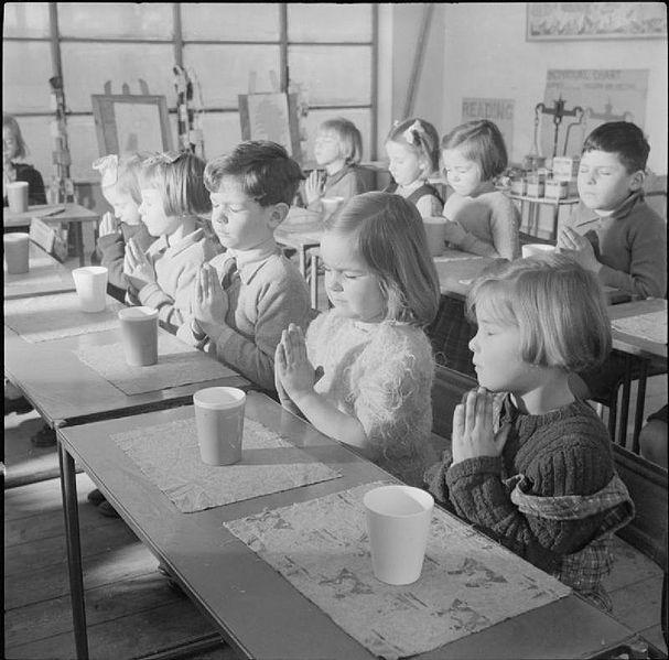 Schoolchildren praying
