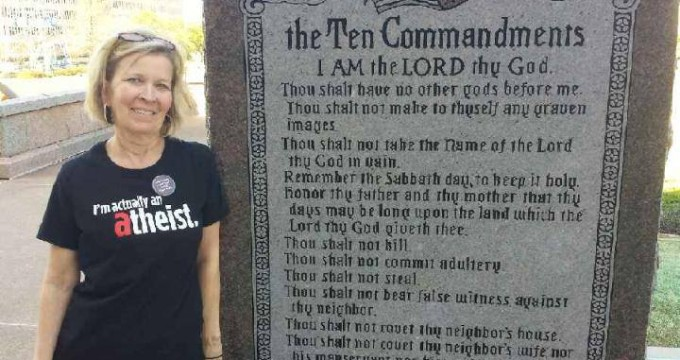 A friend poses with the Constitutionally doomed monument
