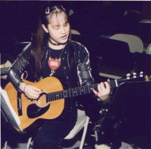 Cherry Teresa playing guitar, teenage years