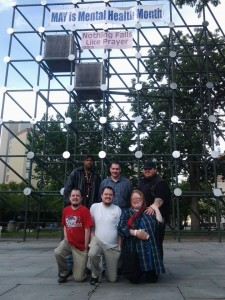 """NEPA Freethought Society members pose under """"Nothing Fails Like Prayer"""" banner"""